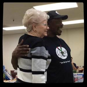 Board Member Judy Snedeker and long-time custodian Charles Johnson at EPI-HAB's 2016 Christmas celebration